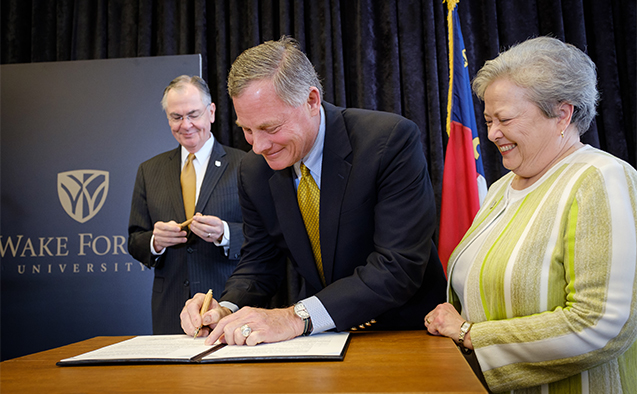 Richard Burr signs paper