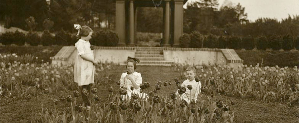 A 1918 photo of Mary, Nancy and Smith Reynolds in Reynolda Gardens. Image courtesy Reynolda Estate Archives, Reynolda House Museum of American Art.