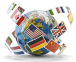 A globe with country flags surrounding it