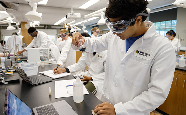 Wake Forest students work on a lab procedure in the general chemistry lab in the newly renovated Salem Hall on Monday, September 10, 2018. First year Zohaib Khawaja ('22) works on his experiment.