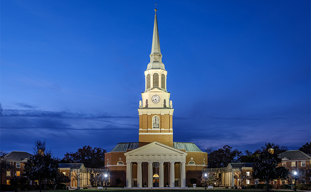 Wait Chapel, on the campus of Wake Forest University, at night.
