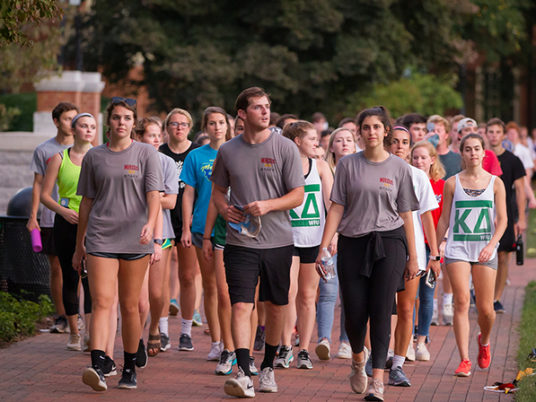 Wake Forest students walk at lap at the 2018 Hit the Bricks event, raising money for cancer research