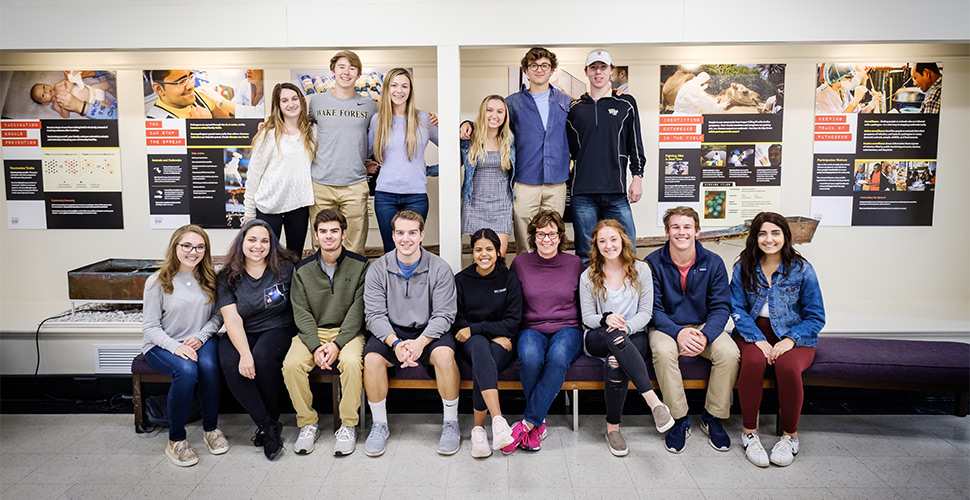 Wake Forest biology professor Pat Lord and the students in her first year seminar hang posters in the lobby of Winston Hall on Thursday, November 8, 2018. The work in the exhibit is on disease outbreaks, epidemics, and their prevention.