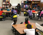 Sixth graders reading in a classroom