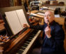 Wake Forest music professor and composer Dan Locklair poses in his studio at his home in Winston-Salem on Monday, July 2, 2018.