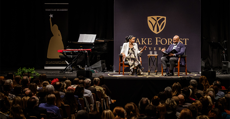 Goldsberry talks with Wake Forest School of Divinity professor Derek Hicks as part of the Arts of Leading conference.