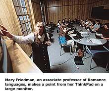 Mary Friedman uses her IBM ThinkPad to teach a class
