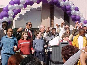 group singing at marker dedication