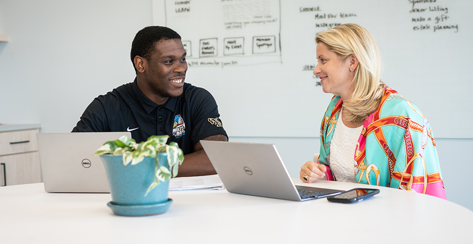 Ja'Cquez Williams works alongside Kate Reece, executive director of the Center for Private Business.