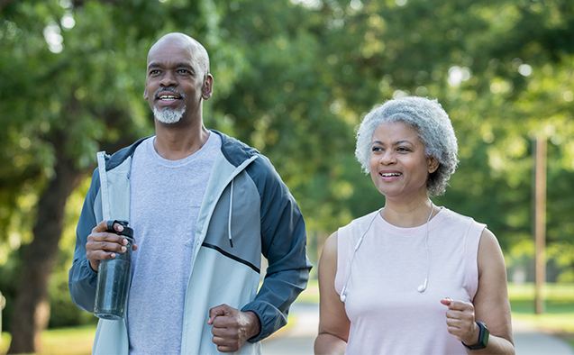 Active senior couple jogging outdoors together