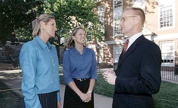 Alice Kirby Horton, a director of the F.M. Kirby Foundation and her daughter, Wake Forest graduate Laura Virkler, speak with Calloway School Dean Jack Wilkerson outside Calloway Hall
