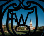 The WF ironwork on Reynolda Hall frames Wait Chapel in the early morning light, on the campus of Wake Forest University on Wednesday, April 10, 2019.