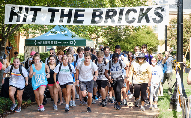 Members of the Wake Forest community run laps around Hearn Plaza to raise money for the Brian Piccolo Fund for cancer research on Thursday, October 4, 2018.