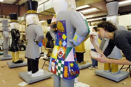 Students making fiberglass versions of the Wake Forest Demon Deacon