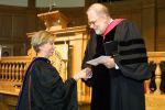Kathleen Kron, left, receives research award from Dean Gordon Melson