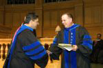 Ajay Patel, left, receives the Kienzle Teaching Award from Dean Charles Moyer