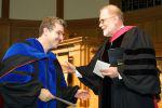 James Schirillo, left, receives research award from Dean Gordon Melson