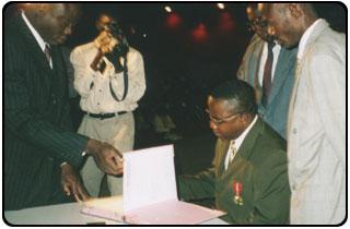 Sylvain Boko, seated, at the award ceremony in Benin