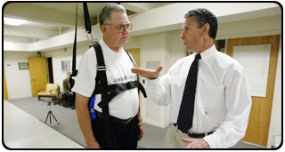 Steve Messier, right, works with a GATES participant in the J.B. Snow Biomechanics Lab.