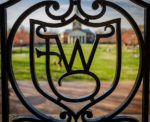Ironwork frames Hearn Plaza on a warm spring afternoon as students enjoy being outside, on the campus of Wake Forest University, Thursday, March 28, 2019.