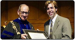 President Hearn presents Jonathan Milner with the Marcellus Waddill Excellence in Teaching Award.