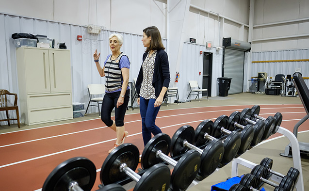 Wake Forest Health and Exercise Science professor Kristen Beavers works with study participant Kaye Brandon at the Clinical Research Center, on the campus of Wake Forest University, Friday, January 17, 2020. The study is looking at whether wearing a weighted vest will prevent bone density loss among older adults who are losing weight for health reasons.