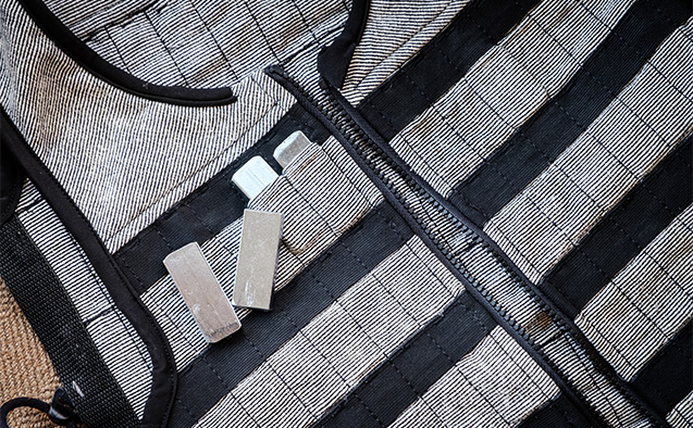 The vest, which weighs two pounds, can be worn under clothes and allows full range of motion.