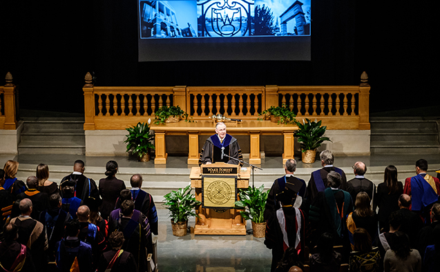 Wake Forest president Nathan Hatch speaks at the lectern