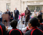 WSSU Chancellor Dr. Elwood Robinson, WFU President Dr. Nathan O. Hatch, and original sit-in protestor Victor Johnson, Jr., lead the memorial at the sit-in site.