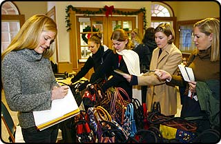 """Jennifer Woodsmall, selling her handbags during a campus """"trunk show."""""""