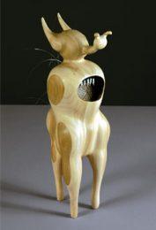 "Leigh Ann Hallberg, 2004; ""de rivando: schizocerca diversicornis"", Mixed media on laminated wood, 18"" x 5 3/8"" x 5"""
