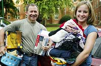 Freshman Elizabeth Bell and her father, Bill, move her belongings into Collins Residence Hall August 18.