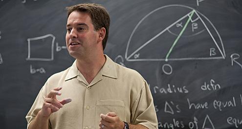 Jason Parsley in front of a blackboard