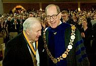"""Willis """"Doc"""" Murphrey ('52, JD '57) receives the Medallion of Merit from President Hearn."""