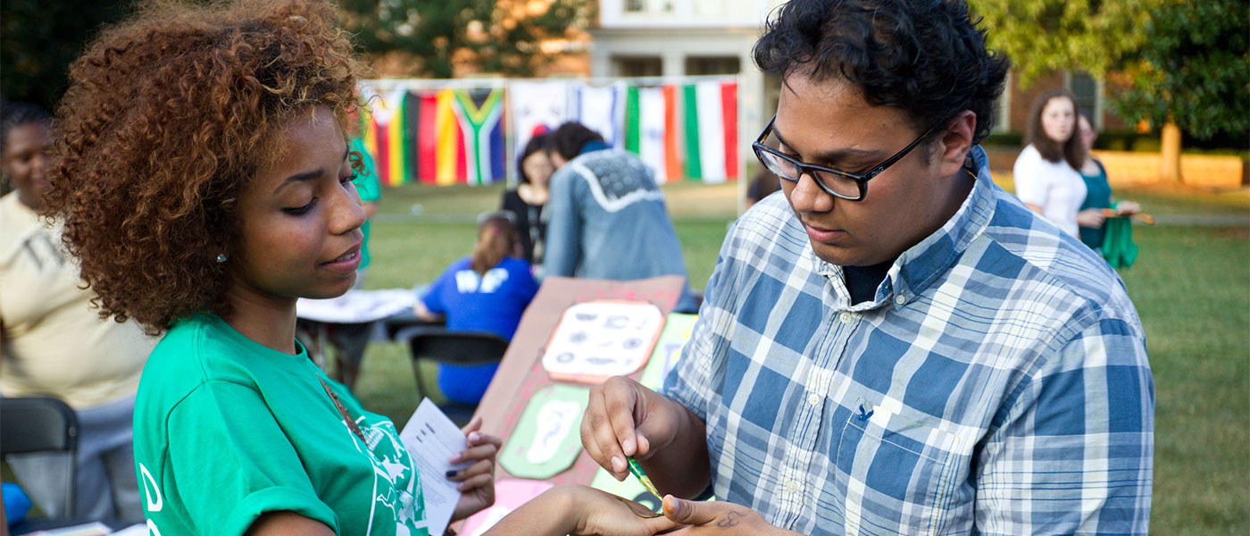 Wake Forest students attend the World Cultural Festival on Manchester Plaza