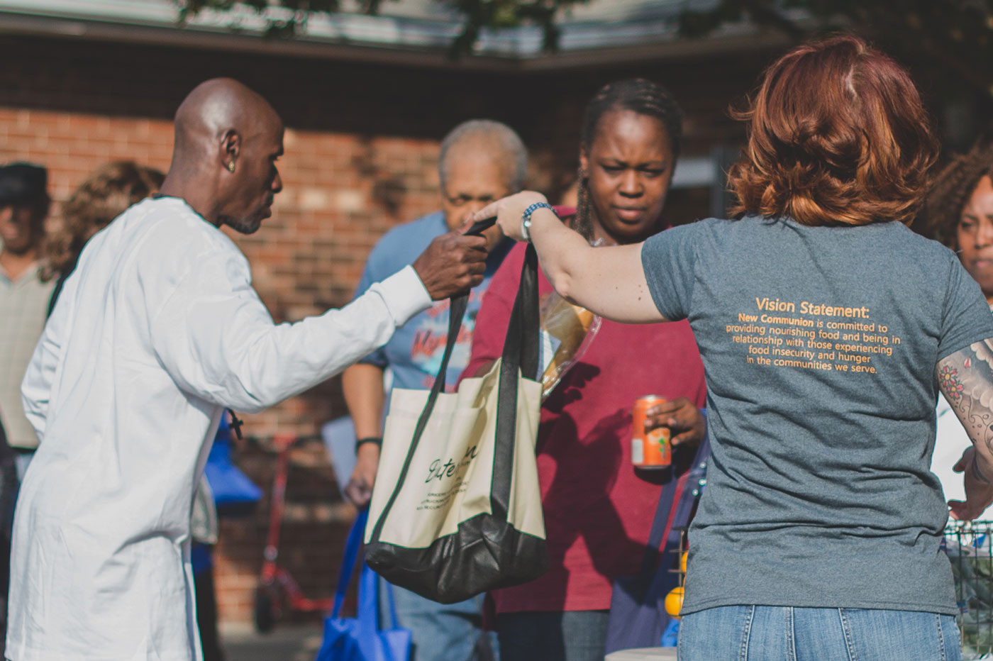 School of Divinity alumna Monica Banks, founder of New Communion Mobile Market and Pantry, hands out produce and other food at a local distribution effort in Winston-Salem North Carolina