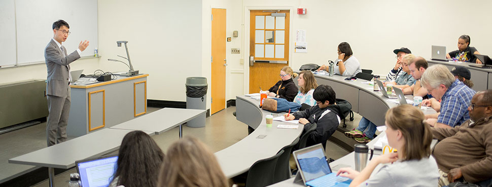 School of Divinity faculty members Kevin Jung lectures during a course session