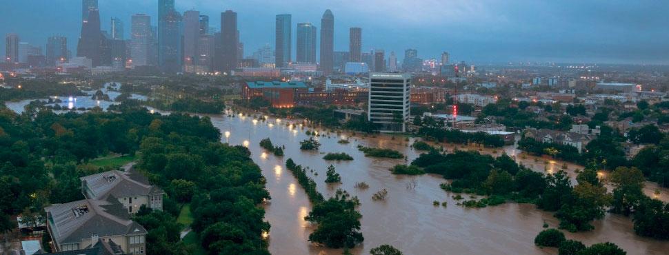 The Buffalo Bayou floods parts of Houston on August 27. [photo from CNN]