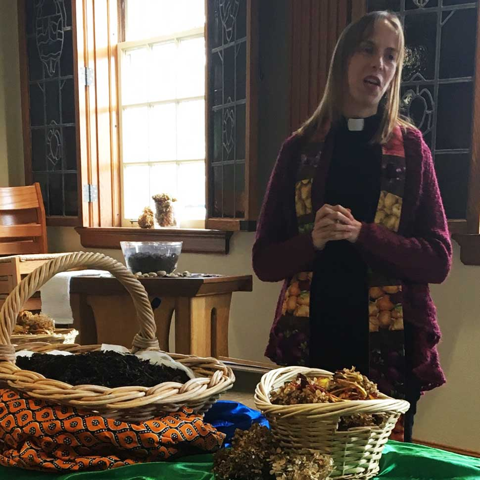 Anna Woofenden leaders a celebration of communion during Community Worship at the School of Divinity