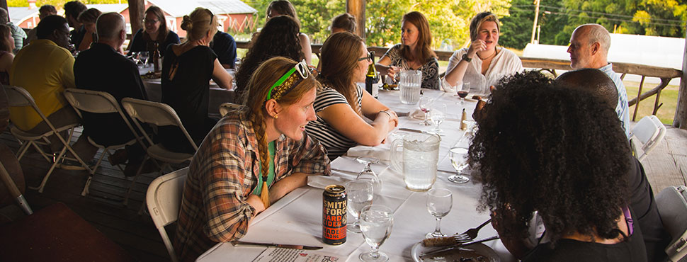 The 2016 Summer Intensive hosted by the School of Divinity's Food, Health, and Ecological Well-Being Program gathers for a dinner celebration on the campus of Warren Wilson College outside of Asheville, NC.