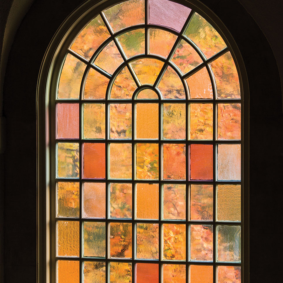 A view of fall color through a window in Wait Chapel on the campus of Wake Forest University early on the morning of Friday, October 26, 2012