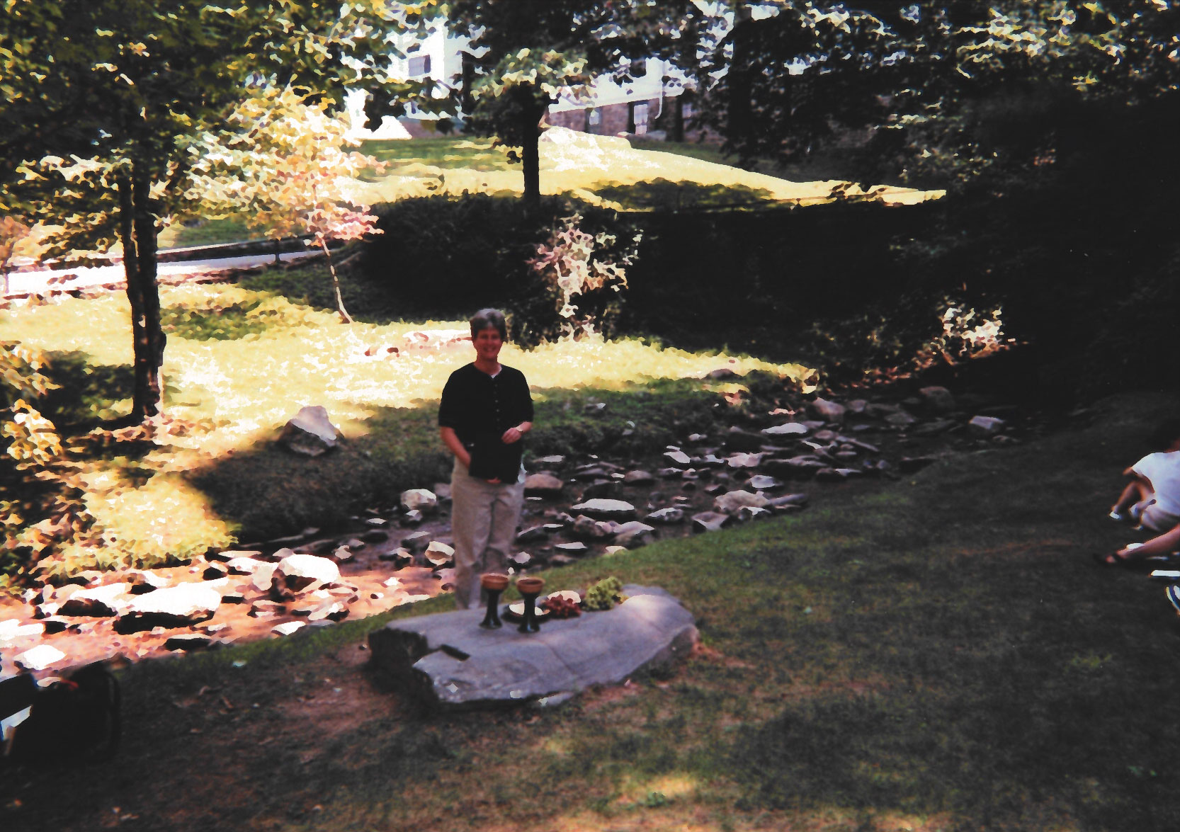Crainshaw prepares to lead Eucharist for the School of Divinity community during a retreat in 1999.