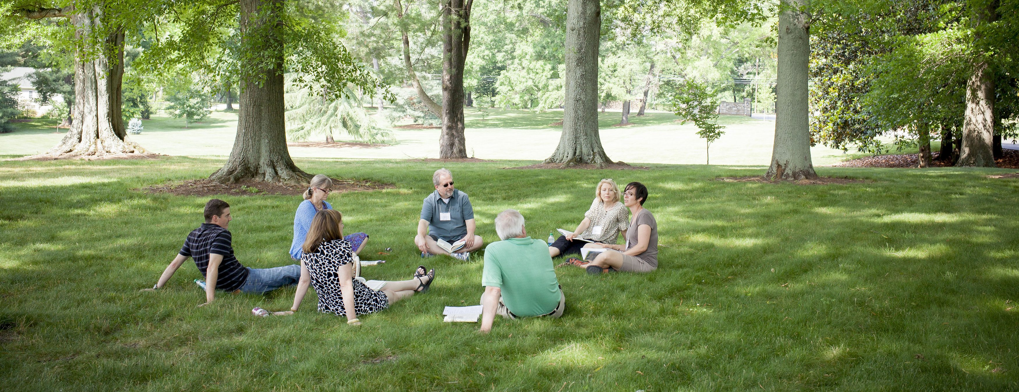 faculty outside on grass