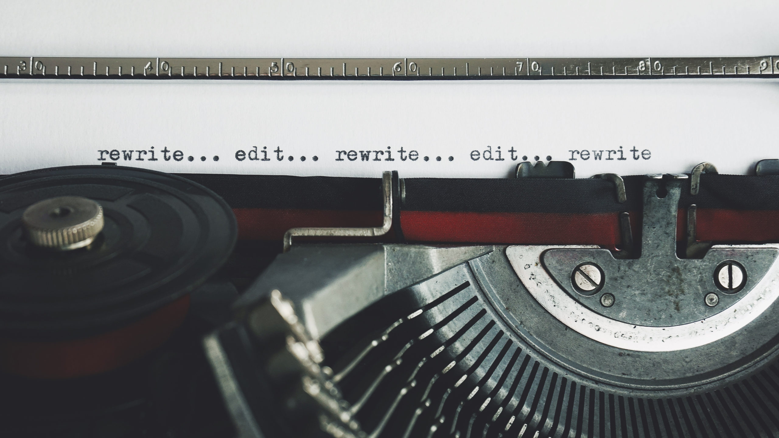 typewriter with rewrite and edit on paper