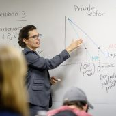 instructor pointing to whiteboard