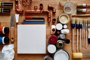 image of a blank canvas with brushes, paint, and supplies