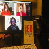 This image shows a videoconference, with the book that's being discussed positioned in the foreground.