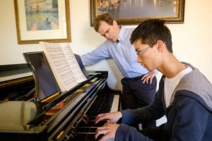 Wake Forest sophomore mathematics major David Yang ('18) works on his Beethoven piece with music professor Peter Kairoff in Scales Fine Arts Center on Wednesday, March 30, 2016. Yang won the Sinal Prize for first place in the piano competition in the annual Giles-Harris Competitions in Musical Performance on campus.