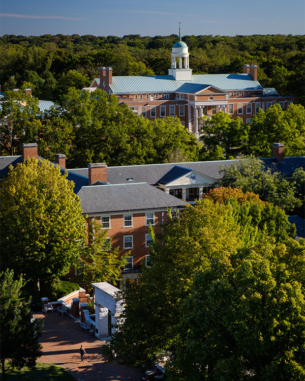 A view of the Wake Forest campus through a window in the bell tower of Wait Chapel