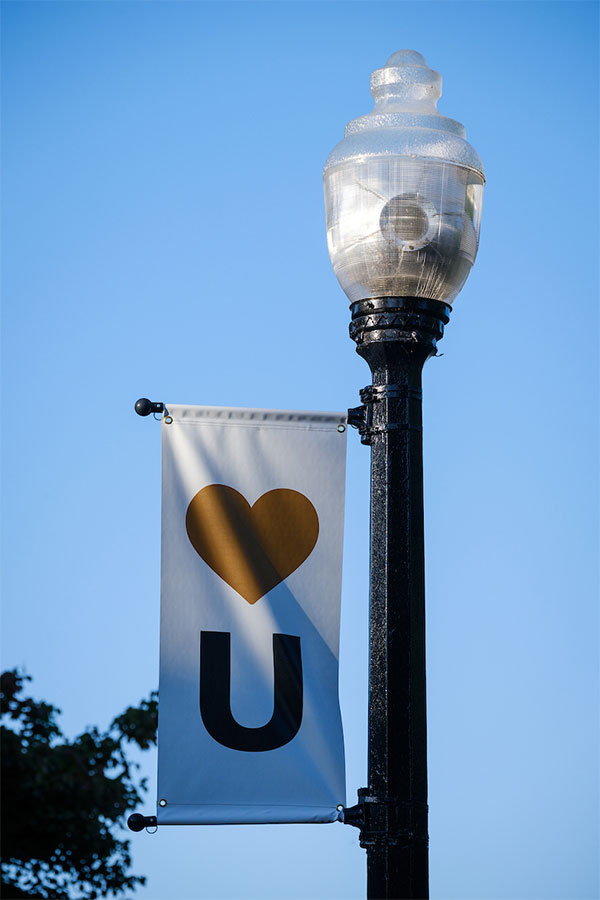 A Show Humanitate banner hangs from a light pole on Hearn Plaza